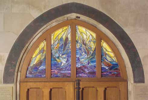 The Baptistry window at Wimborne Minster was commissioned by Michael's parents in his memory and designed by the stained glass artist Henry Haig