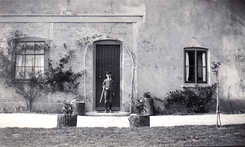 Don, aged 7, outside the family home at Arne