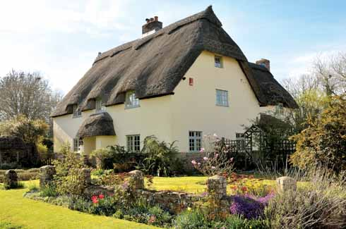 This splendid house is known as Well Cottage, on account of the thatched well within its grounds