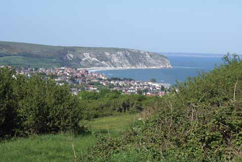 Swanage and New Swanage with Ballard Point beyond and Bournemouth in the distance