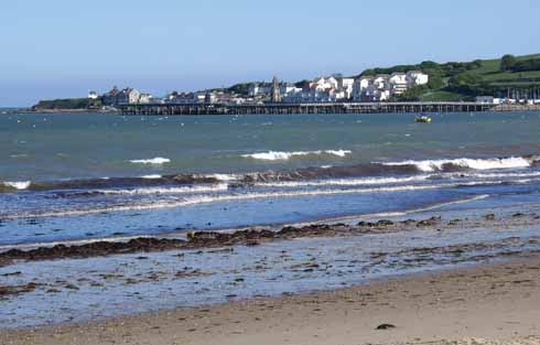 Swanage looking south to the pier head and sailing club, which are overlooked by modern developments