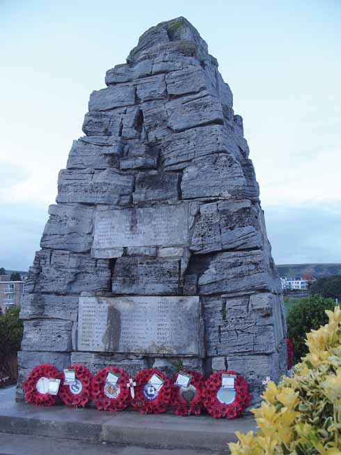 The Swanage war memorial with wreaths from those honouring the town's fallen from two world wars