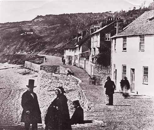 The earliest photograph of The Walk, taken in the 1850s, probably even in the early 1850s. The Assembly Rooms are behind the photographer. The Walk is well gravelled, and the slope behind the beach very bare. The square sticking out from the path is the remains of West Fort, built in 1627 and removed in 1862.