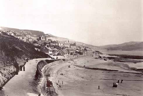 The Walk looking eastwards in the 1870s with the cart road below it. In the near distance is a cart, but it is moving too quickly for the camera to have captured it crisply.  Courtesy Lyme Regis Philpot Museum