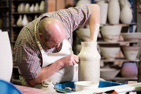 Masterpotter, Alan White, at work at Poole Pottery