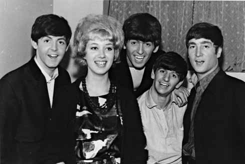 Backstage – Aug 1963: The Beatles with photographer Harry Taylor's daughter Sandra backstage at the Gaumont in August 1963