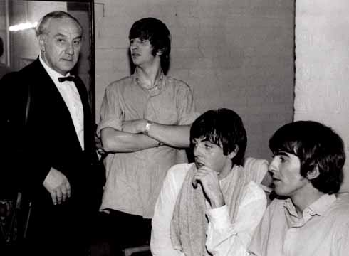 Backstage – Aug 1964: A rare occasion when Harry Taylor appeared in one of his own photos, as daughter Sandra grabbed this shot of him in The Beatles' dressing room with Ringo, Paul and George at the Gaumont on 2 August 1964