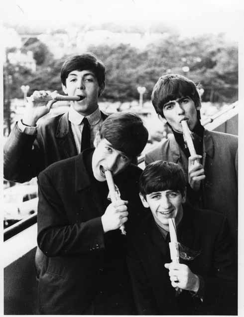 Balcony – Aug 1963: Bournemouth Rock! Harry Taylor posed The Beatles on the first floor balcony of the Palace Court Hotel overlooking Westover Road in what is the only known set of photos of the Fab Four eating sticks of rock