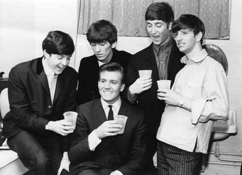 Billy J Kramer Birthday – Backstage: Between shows at the Gaumont on the opening night of their summer season, 19 August 1963, The Beatles hosted a party in their dressing room for support act Billy J Kramer's 20th birthday
