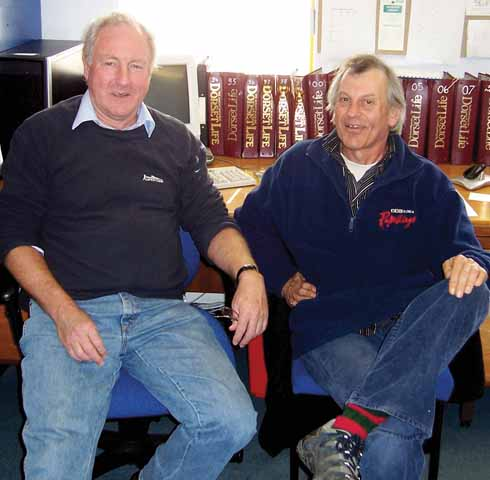 In the Dorset Life office: John Newth (left) and Rod Legg with walking boots