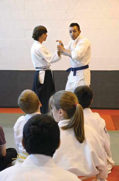 Boys and girls of the junior division of Ferndown Jitsu Club learning how to defend themselves against an assailant