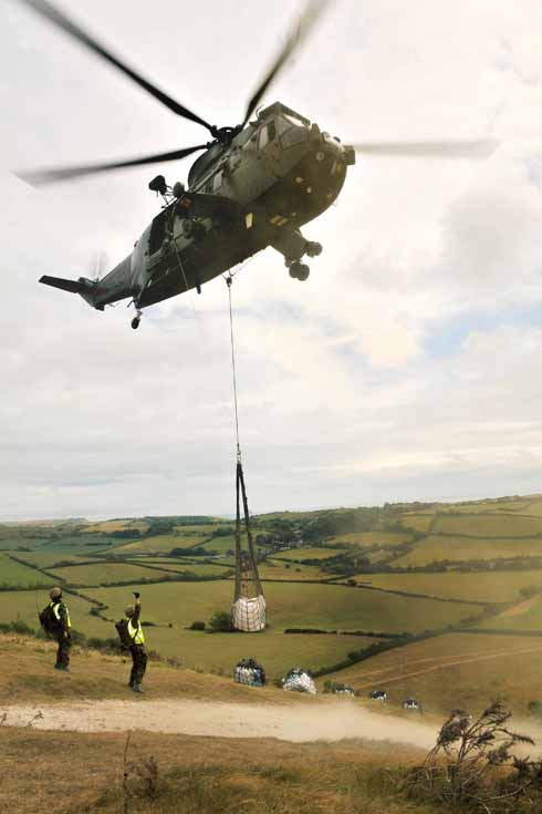 A helicopter takes away the unwanted stone chippings