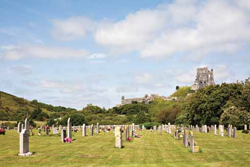 Corfe Castle now overwatches the village's cemetary