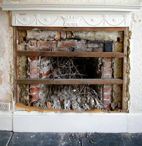 Fireplace that had been covered – the chimney was stuffed with various materials to keep the draught out!