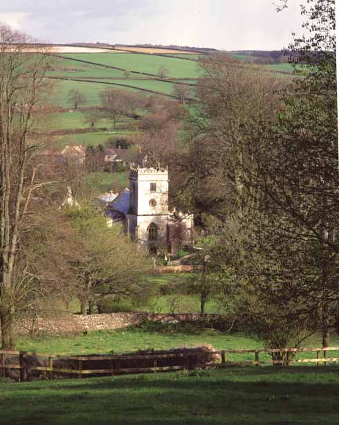 Returning from an assignation with his lover Felice, Fitzpiers hears the clock of 'Newland Buckton' church strike midnight – actually the Church of the Holy Rood in  Buckland Newton