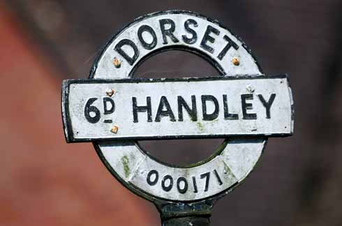 The abbreviated lettering to save space on finials at Sixpenny Handley