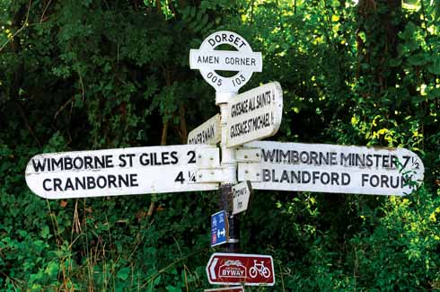 A traditional fingerpost complete with finial and original curved fingers at Amen Corner, Gussage All Saints