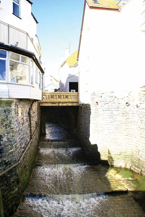 The River Lim passes under the main road on its final journey to Lyme Bay