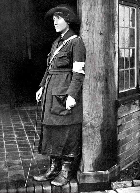 Mabel St Clair Stobart in around 1916. She wears her uniform of heavy jacket with a Red Cross armband, long split skirt, and stout boots.