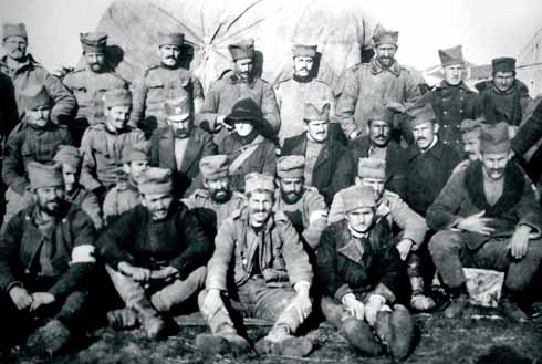 Mabel surrounded by piratical-looking Serbian soldiers. In her diary she recorded the men's deep respect for the nursing staff (author's collection).