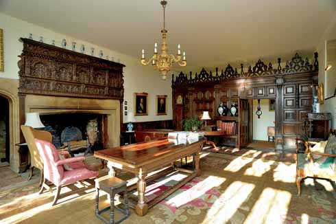Above the fireplace is a carved wooden overmantel with a Jacobean central section. On the right is a Jacobean screen which separates the hall from the entrance passage.