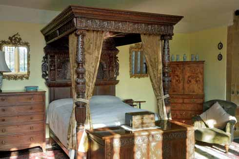 Part-Jacobean, part Victorian carved bed in the former solar
