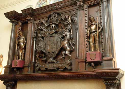 Carved overmantel bearing the arms of James I which came from the Joiners' Hall in Salisbury