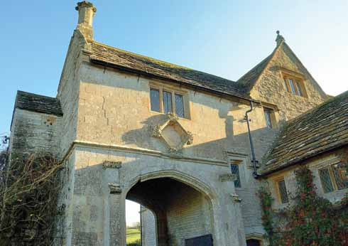 The west face of the gatehouse on the north side of the manor house. On the left is one of the small quatrefoil windows.