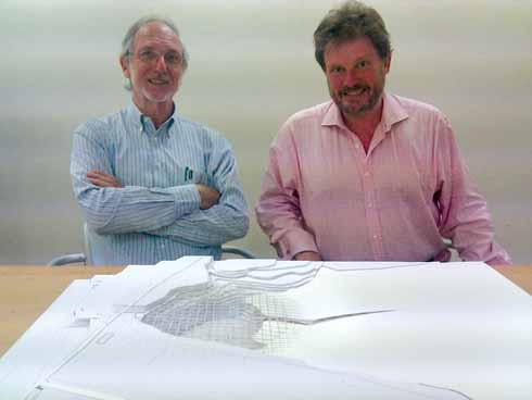 Michael Hanlon (right) with renowned architect Renzo Piano in front of a model showing Jurassica's lattice roof