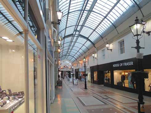 The inside of the light and airy arcade was and is an excellent place to shop when the streets outside are teeming with rain