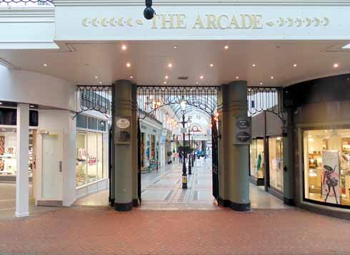 Beyond the sombre and compact entrance, the arcade opens up to be wide and bright
