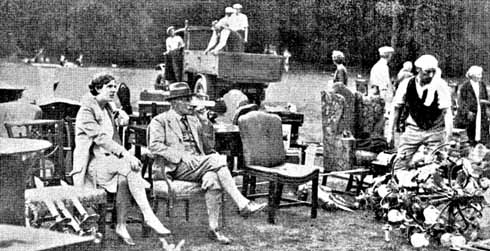 Herbert Weld sits on the lawn, surrounded by his possessions, during the disastrous  fire of 1929