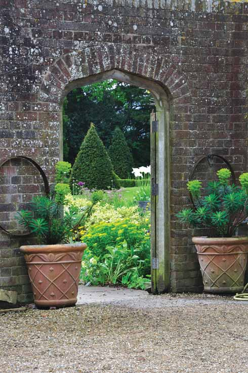 The entrance to the garden is through a delightful doorway in the brick wall