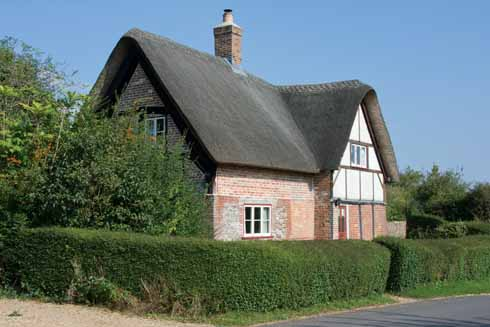One of a number of the attractive vernacular styles in Shapwick is the thatched brick and timber cottage