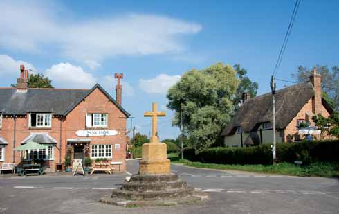 No longer a stump, the memorial cross sits in front of the community-owned Anchor pub
