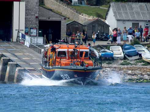 Robert Charles Brown being launched from the old Swanage lifeboat station, in which the new Shannon class boat would not fit
