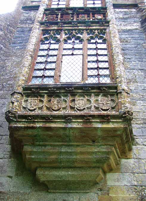 The double oriel window of the Abbot's Porch has panels enclosing shields of arms and rebuses of Abbot Sam, Bishop Hugh Oldham and other benefactors