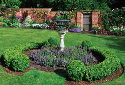 The armillary in the centre of the lawn makes an intriguing focal point