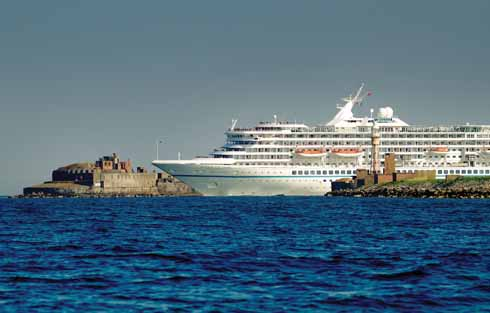 The 44,000 tonne cruise ship Artania leaving Portland Harbour for Weymouth Bay; Portland is becoming an increasingly popular destination for cruise ships
