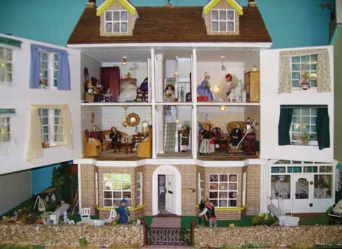 Smaller yet than the Model Town are the Dolls' Houses donated by Beryl Dade