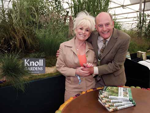 Neil with Barbara Windsor at the launch of his book on designing with grasses
