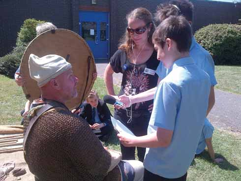 Debra Hearne oversees an interview with 'Thurston', a Saxon chief following his victory in battle against the Vikings on the South Dorset Ridgeway (actually the Wey Valley School playground!)