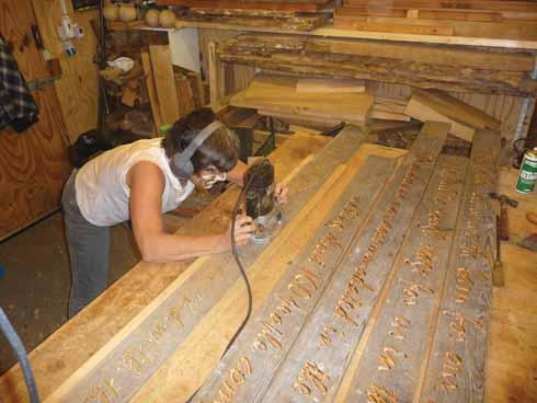 Lynda routing planks for the stage in Tyneham Barn, September 2009