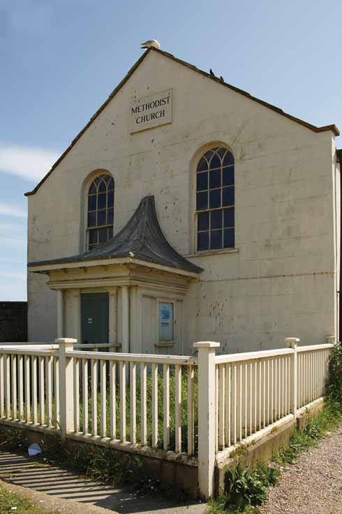 The Methodist church is one of the buildings at West Bay which, in the words of Sir Frederick Treves, 'sits knee deep in shingle with [its back] turned to the ocean'