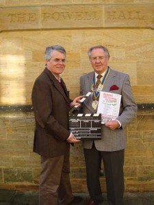SHIFF Director Roger Johnson and the Rotary Club of Sherborne Castles President, Michael Peart, outside the Powell Theatre at the inaugural event in 2009