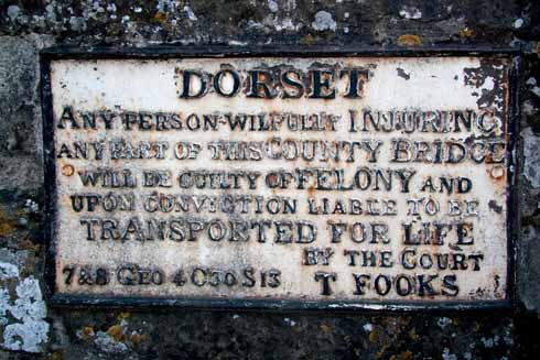 Many a Dorset bridge bears a similar sign threatening transportation to Australia as a punishment for wilfully injuring the bridge