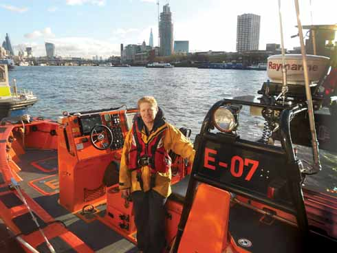 Holly on board an E-class boat at Victoria Embankment on the Thames with (right to left) the LWT building, Southbank Tower, Shard, Walkie Talkie, Cheese-Grater and Gherkin beyond