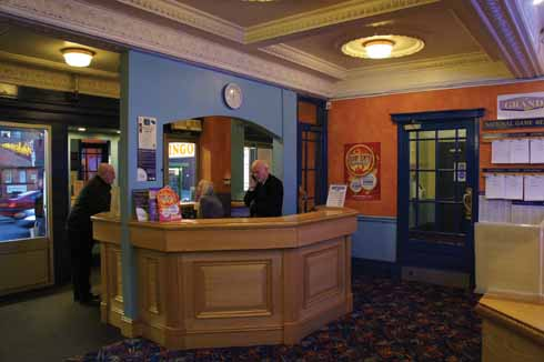 The foyer and former ticket kiosk at the Grand