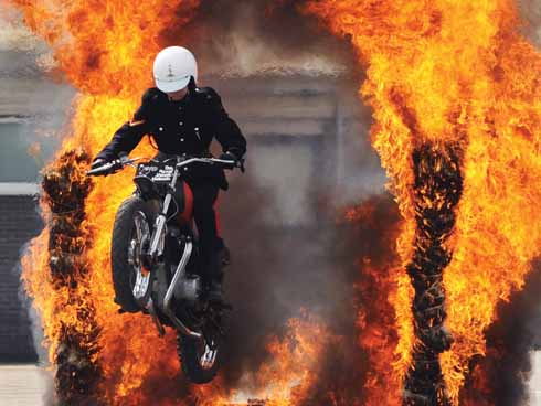 The Fire Jump: it's the initiation if you like, the pinnacle of [trainees'] training – they lose their eyebrows and trade in the black helmet they wear in training for a white helmet