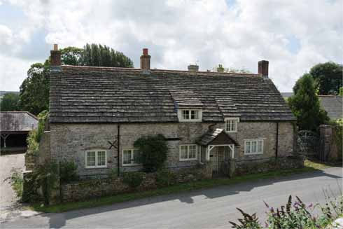 The vernacular stone construction and especially the increasing size of the stone slabs used as roofing are clearly evident on this fine example of a Purbeck cottage